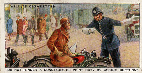 Road safety advice - do not hinder a police officer on point duty by asking questions